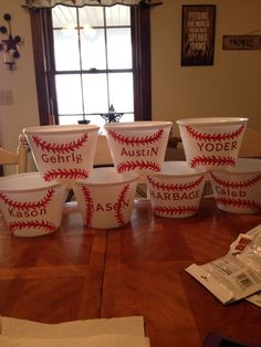 """Baseball gift buckets. Buy $ store bucket, apply letter stickers, and paint on baseball stitches!! Fill with Big League Chew, Sunflower seeds, and peanuts. """"batter up"""""""