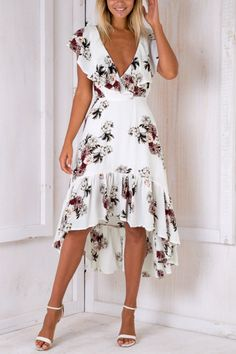 This sexy dress is undoubtedly one of the most right choice in this season. It designed with backless, v-neck details, floral print and flounced hem. It will be great if you team with high heels.