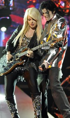 Orianthi Panagaris was the lead guitarist for Michael Jackson for his This Is It concert series, and as the lead guitarist in Alice Cooper's live band. #GirlsWhoPlayInstruments #SexiestFemaleMusicians