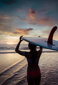 Endless Summer sunset in Tamarindo Costa Rica. Surfer silhouette. Surfer holding their surfboards on the beach. Rainy Season Costa Rica Sunsets   sunset, sunsets, beach sunset, sunset ocean, sunset photography, sunset pictures, sunset sky, sunset beautifu