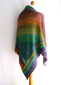 """This bottom up shawl uses Cascade's """"Souk"""" yarn to great effect. Knitting a stocking stitch triangle for the main body. Stitches are then picked up around the edges to form the garter stitch border. This self striping yarn does all the work for you. Creating a colourful, lightweight, yet warm garment."""