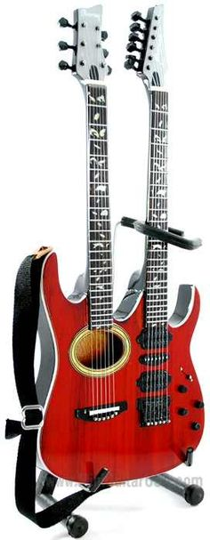 Steve Vai, double neck acoustic electric...what every true guitarist wants to be able to play :D http://www.guitarandmusicinstitute.com