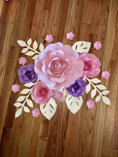 A personal favorite from my Etsy shop https://www.etsy.com/listing/534342789/5-pc-paper-flower-wall-decor