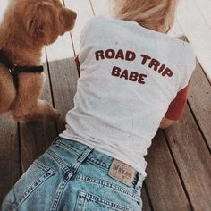 - Road Trip Babe Tee - Available in Red w/ red flocked lettering - Sizes S, M, L - 50% Polyester/ 50% Cotton - Made in USA