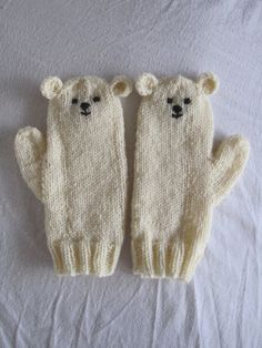 Polar bear mittens -- knitting inspiration (pin takes to site for product purchase, no pattern)