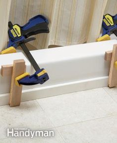 How to Fix Vinyl Flooring: Glue a solid surface threshold along the tub/vinyl floor joint to stop vinyl curling and make your bathroom look clean and fresh. http://www.familyhandyman.com/floor/vinyl-flooring/how-to-fix-vinyl-flooring/view-all