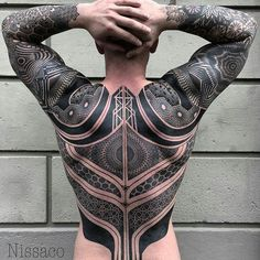 "This men's back piece is made by @nissaco and it's called ""The Battle Suit"""