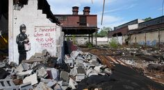 """""""I Remember when all this was trees..."""" Detroit. Environmental message by graffiti artist Banksy."""