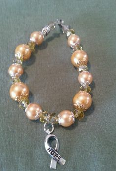 Childhood cancer awareness gold pearl bracelet