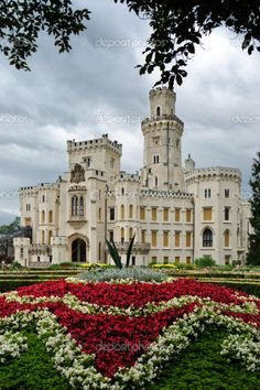 Old german castle with flower bed. This is a stock photo on several websites, none of which have an identification of the castle. That doesn't make it any less beautiful, though.