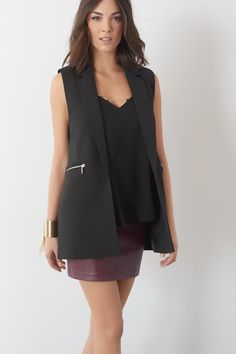 Add a sexy faux leather skirt an this sleeveless blazer takes you from the boardroom to the bar!