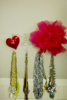 Fun way to hang your necklaces. I want that giant pink flower.