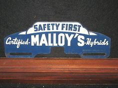 Old Malloy's Hybrid Seed Corn Advertising Metal License Plate Topper Farm Sign