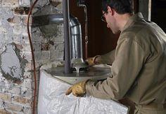 Worker Installing Hot Water Heater Blanket