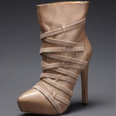 """L.A.M.B. Leather 'Piplette' Bootie Taupe L.A.M.B. 'Piplette' Leather Bootie. 5"""" Heel with Hidden platform. A luxe bootie in a neutral shade that will go with just about anything. Complete Leather upper and sole. Suede straps wrap around front. 5"""" shaft height. Pull-on style, no zippers. 12"""" opening. 1"""" platform, 5"""" covered heel. Brand new, never worn. Kept in box since purchase. New in L.A.M.B. Box. Dust bag included. Lower thru Merc. L.A.M.B. Shoes"""