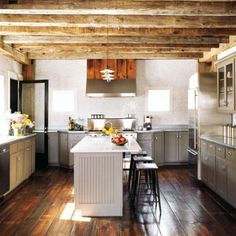 barn house... love the rustic wood mixed with modern furniture... beautiful- right down to the sunflowers
