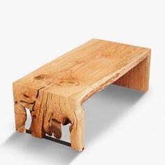 An oak single slab bi-fold coffee table. We salvaged this tree in Bellevue, Washington.