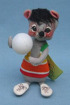 """Annalee 7"""" Volleyball Mouse:  This doll features Open eyes, closed mouth smile as shown, grey body, black hair, yellow/orange/red/green stripe shirt, holds volleyball. Only made for one year. RARE"""