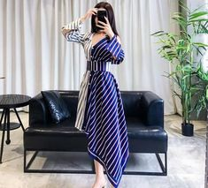 Asymmetrical Patchwork Two Toned Shirt DressSilhouette: A-LineSleeve Style: RegularMaterial: LanonNeckline: Turn-down CollarDecoration: Ruffles dresses Asymmetrical Patchwork Two Toned Shirt Dress