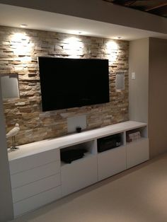 Basement stone entertainment center with ikea cupboards http://www.shannacreations.ca/blog.html