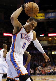 Oklahoma City's Russell Westbrook (0) slams the ball in frustration during an NBA basketball game between the Phoenix Suns and the Oklahoma City Thunder at Chesapeake Energy Arena in Oklahoma City, Sunday, Dec. 14, 2014. Photo by Nate Billings, The Oklahoman