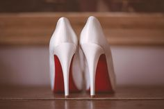 Red sole shoes by Christian Louboutin. Photography by www.jayrowden.com