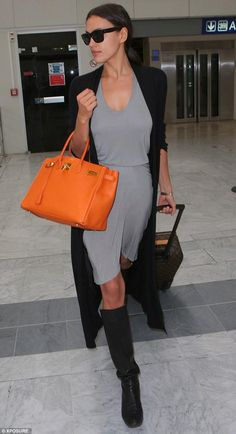 Irina Shayk wearing Lanvin. Black Textured-Leather Wedge Knee Boots, Louis Vuitton Monogram Canvas Pegase, Celine Original 1732 Sunglasses and Hermes Birkin Bag 40cm Orange Togo