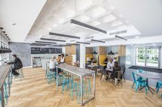 Woodhouse removed the original marketing suite of Ashton House and inserted a café in lieu, creating one large open space combined with the reception, building on volume and light. Cafe House, New City, Minimal Design, Being A Landlord, Rid, Minimalism, Finger, Reception, Marketing
