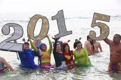 Plunging into the Gulf at Flora-Bama's Polar Bear Dip, wild costumes and all on New Year's Day | AL.com
