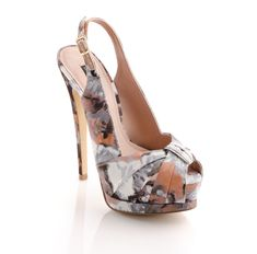 With pretty petals springing up on the runway, it's time to live out your floral fantasy. This slingback heel features a blooming watercolor print and crisscross bow detail for ladylike appeal. A front platform takes the design's feminine vibe to new heights for a polished look from head to heels.5 3/4