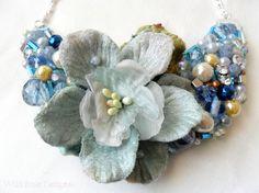 Simply gorgeous handmade statement necklace! It features a dusky blue velvet…