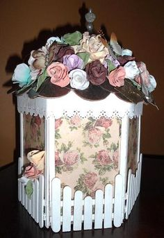 This is a gazebo exploding scrapbook as it looks before you open. Look at the detail these are all hand rolled roses and everything is hand done except the little birdie! This is my friend's work you will be seeing many more wonderful things she does in the coming weeks!