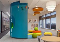 The curved wall acts as a divider between the children's play area and the main