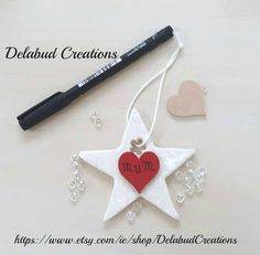 Handmade personalised ceramic heart-Star with by DelabudCreations Baby Gifts, Clay, Ceramics, Drop Earrings, Christmas Ornaments, Holiday Decor, Heart, Unique Jewelry, Handmade Gifts