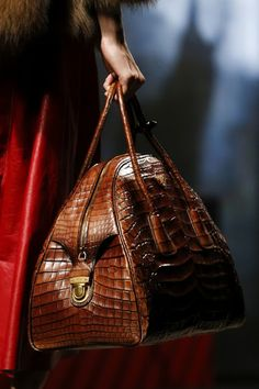 Bags from Prada A\W 2014 from Milan Fashion Week. The blonde in the pic.