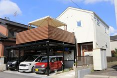【アイジースタイルハウス】ガレージ。広いテラスが目を引く外観