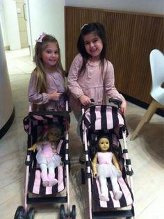Sophia Grace  Rosie with their namesake American Girl dolls.