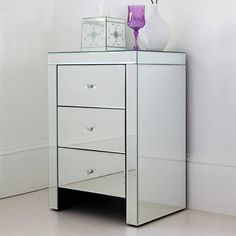 A stunningly simple and beautifully made wide mirrored bedside table. Description from polyvore.com. I searched for this on bing.com/images