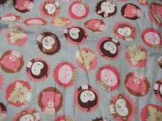 Cute Baby Animal Faces on this Babies Crib Quilt