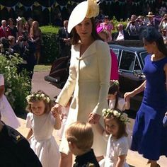 Catherine with the bridesmaids and pageboys She is stunning ! I was hoping for a new dress or outfit but I really love this…
