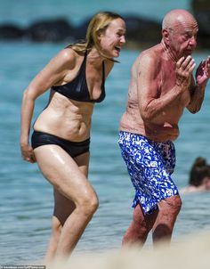 Sunshine break: Rupert teamed a navy poloshirt with patterned blue and white swim shorts and a baseball cap, later stripping his shirt off for a cooling dip in the ocean Mature Women Hairstyles, White Swim Shorts, Slimming World Recipes Syn Free, Stylish Older Women, Jerry Hall, Beautiful Old Woman, Celebrity Bikini, Actrices Hollywood, 60 Fashion