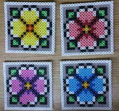 Flower coasters hama perler beads by Sonja Ahacarne Perler Bead Designs, Hama Beads Design, Diy Perler Beads, Perler Bead Art, Melty Bead Patterns, Hama Beads Patterns, Beading Patterns, Pixel Beads, Fuse Beads