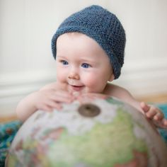 This little cutie loved playing with old globe. www.rosemcmahon.com