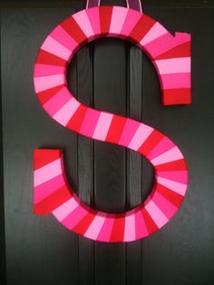 wrapped in ribbon (or painted), could do this on the kids bedroom doors!!
