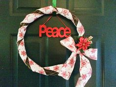 Simple Christmas grapevine wreath made w/ dollar general finds.