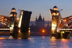 """Питер - Столица мира! - """"Piter - capitol of the world!"""" - the openable bridge on the river Neva during the white nights; it used to be opened in that term."""