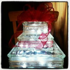 Use one of these as ice with blue lights in it and put wine glasses filled with red gel balls and a tea light.