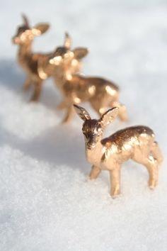 gold spray painted plastic animals. Brilliant simple decor, ornaments, etc.