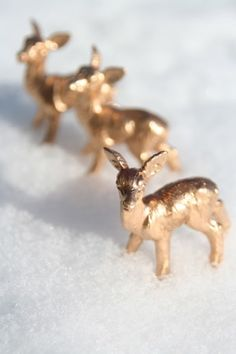 gold spray painted plastic animals. Brilliant simple decor, ornaments, etc.