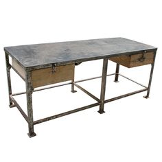 Industrial table from France, probably from the turn of the century. Recently stripped and polished. 2 wooden draws. This Item is not for sale and available for rental only.